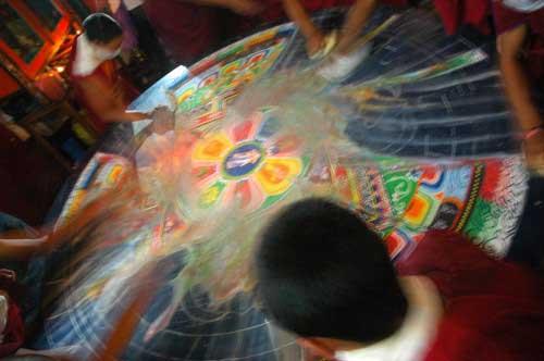 Monks destroying a sand mandala