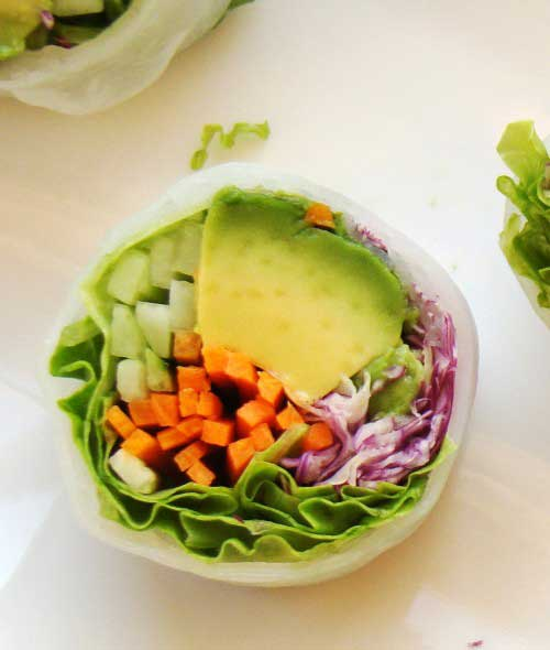 a vegan sushi roll with veggies