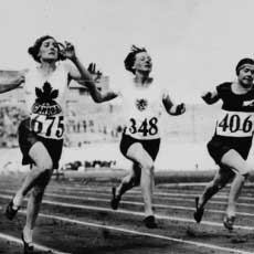 Myrtle Cook of Canada (left) winning a preliminary heat in the women's 100 metres race at the VIIIth Summer Olympic Games