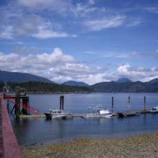 Preparing for the simple life on Cortes Island, B.C. A dock on the ocean with mountains in the distance.