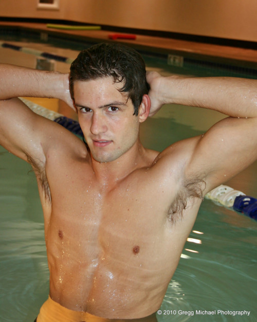 Jacob Goodall (model and Hollywood actor) stretching in a pool.