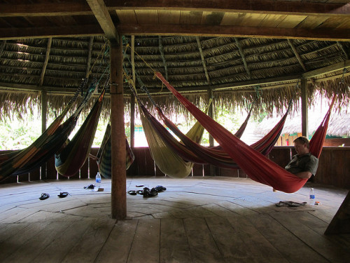 Several hammocks in a palm roof hut; the original space saving furniture.