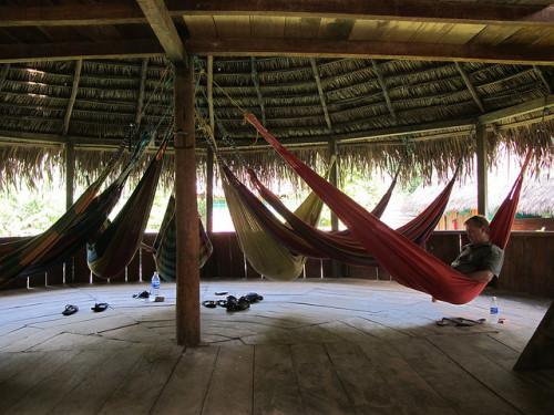 Several hammocks in a palm roof hut; the original space saving furniture.