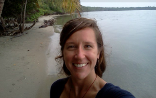 Photo of my friend Jess on a tropical beach. She's a travelling volunteer.