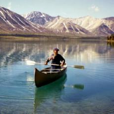 Dick Proenneke Alone in the Wilderness paddling a canoe in Twin Lakes, Alaska