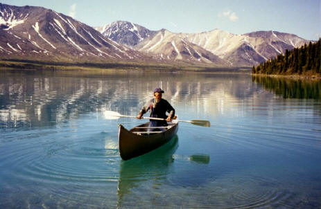 Dick Proenneke Alone in the Wilderness paddling a canoe in Twin Lakes, Alaska