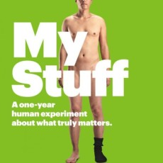 """A nude man stands against a green background with the words, """"My Stuff"""" covering his genitals."""